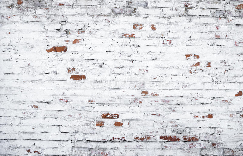 Пакостная кирпичная стена стоковое изображение