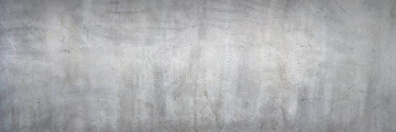 Пакостная серая бетонная стена стоковые изображения rf