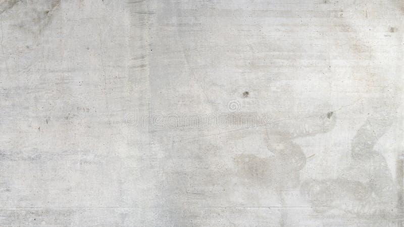 Пакостная серая бетонная стена стоковое изображение