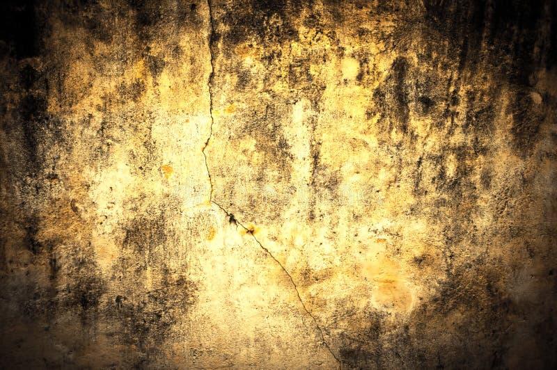 пакостный желтый цвет стены текстуры стоковые фото