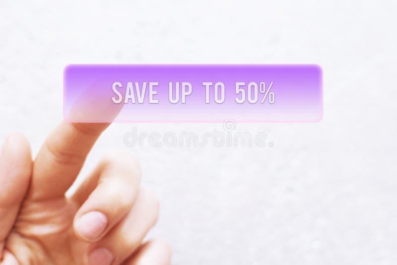 Палец отжимая фиолет - спасение до 50% - кнопка стоковое фото