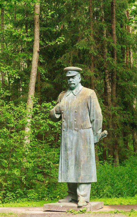 Памятник к Сталину в парке Grutas стоковое изображение