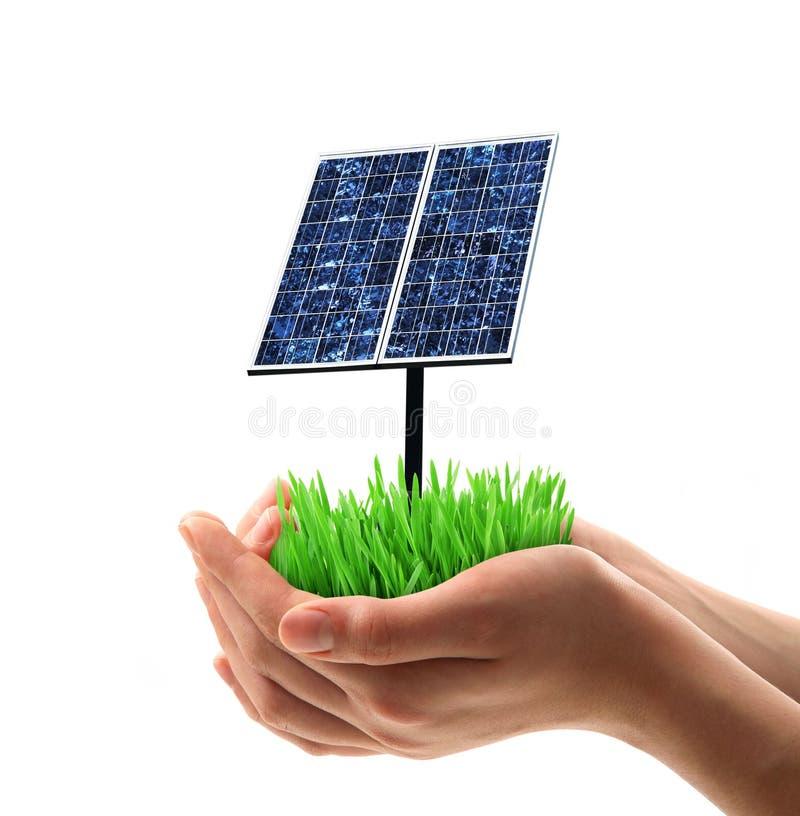 Панель солнечных батарей, который держат в руке стоковые фотографии rf