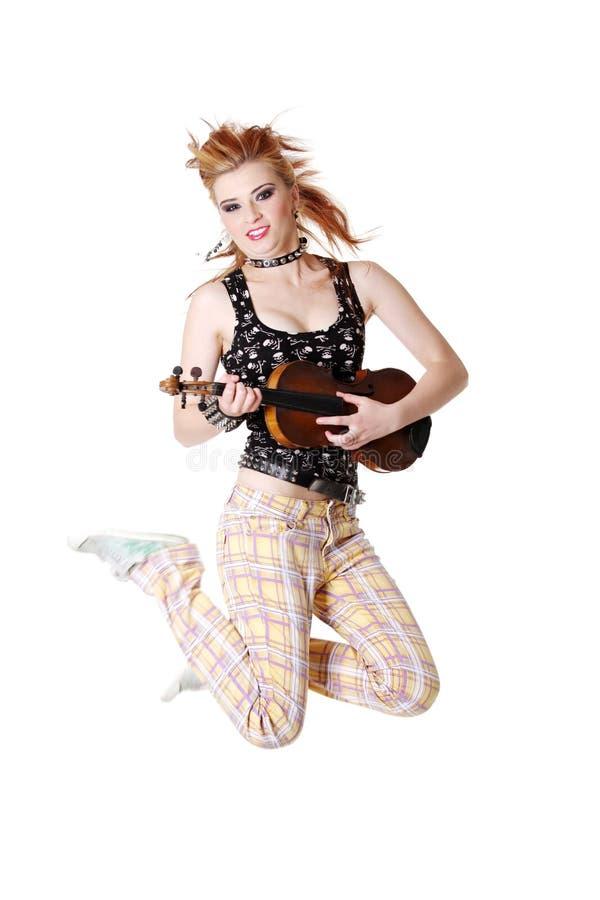 панк девушки скрипки скача стоковая фотография rf