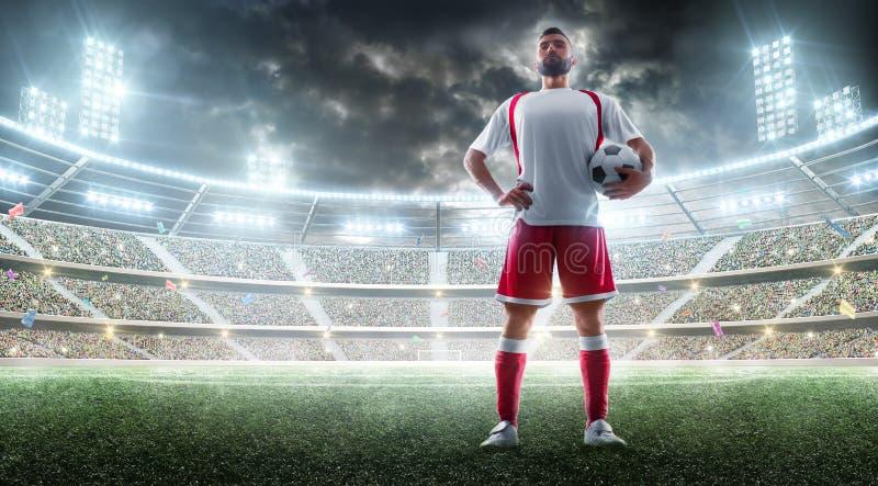 Панорама стадиона ночи Футболист держит футбольный мяч изолированная принципиальной схемой белизна спорта Модель-макет стоковые фотографии rf