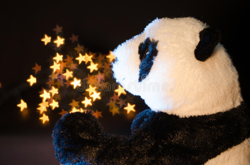 Панда и звезды стоковые фото