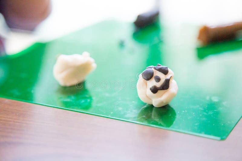 Панда сделанная из глины стоковые фото