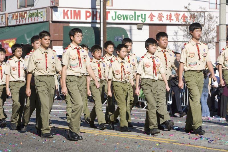 парад мальчика китайский новый scouts год стоковое изображение