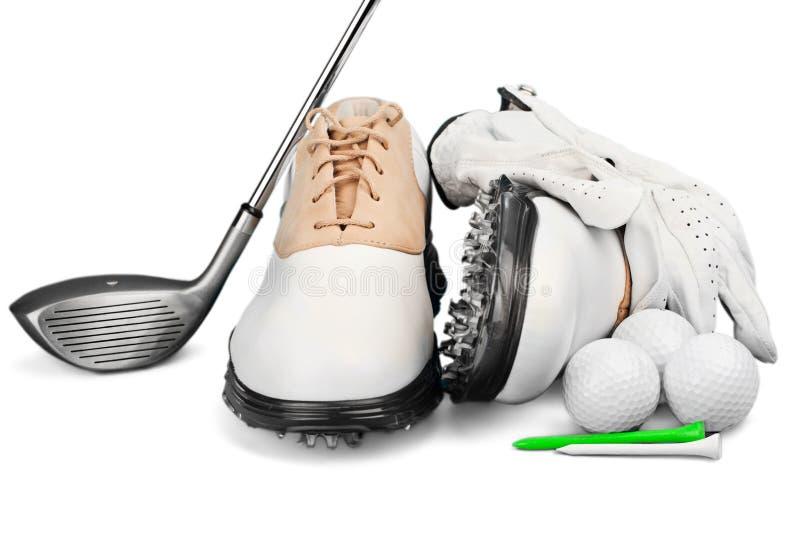 Пары ботинок гольфа с перчаткой, шариком, тройниками и гольфом стоковое фото rf