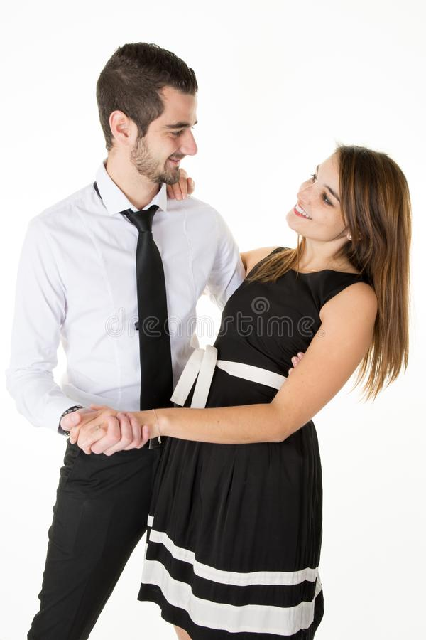 Пары в влюбленности усмехаясь и смотря один другого стоковое фото