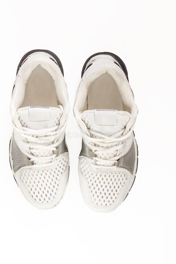 Пары идущих ботинок изолированных в белой предпосылке С clippin стоковые фотографии rf