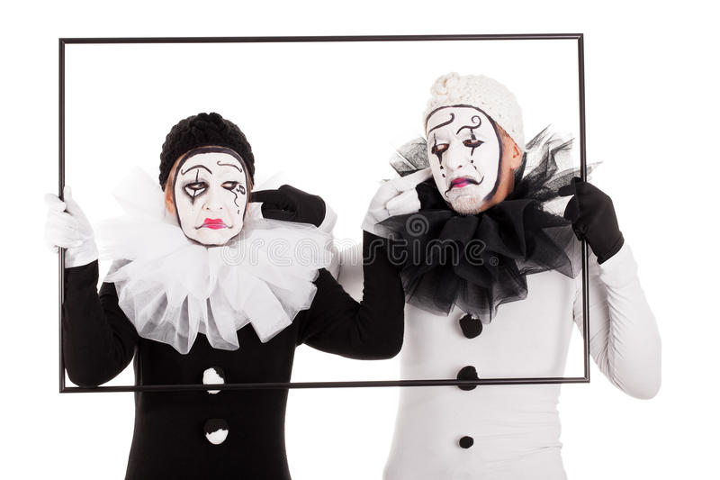 2 клоуна в cant рамки слышат один другого стоковое изображение rf