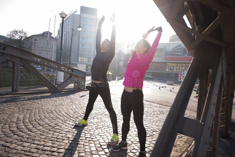 Пары нагревая перед jogging стоковое изображение