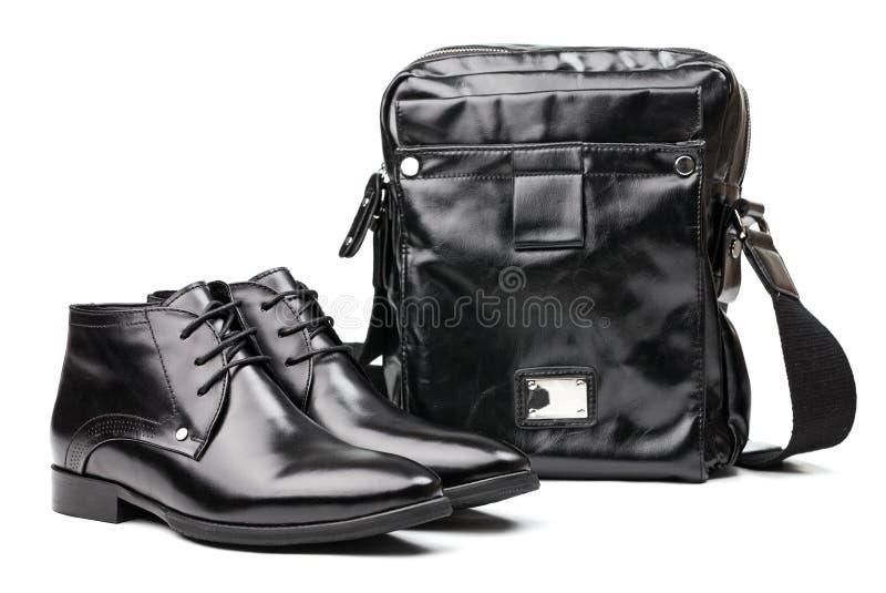 пары посыльного людей ботинок мешка черные стоковые фото