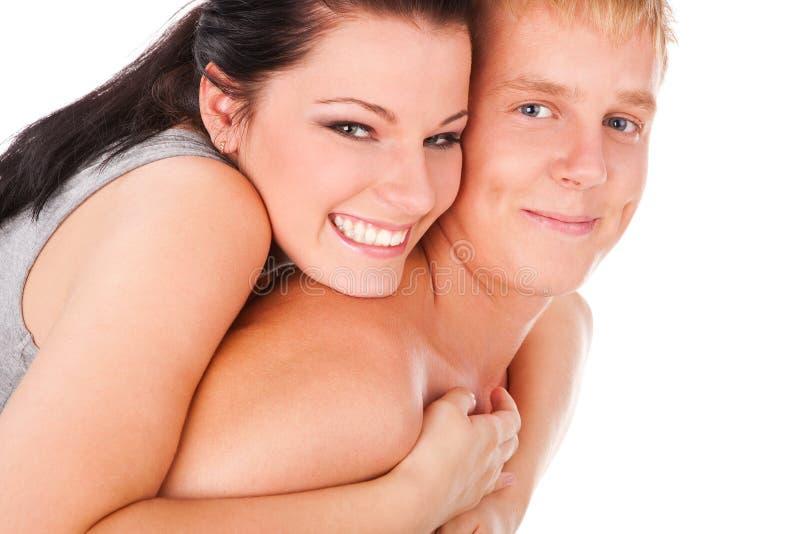 пары прижимаясь счастливый подросток стоковая фотография rf