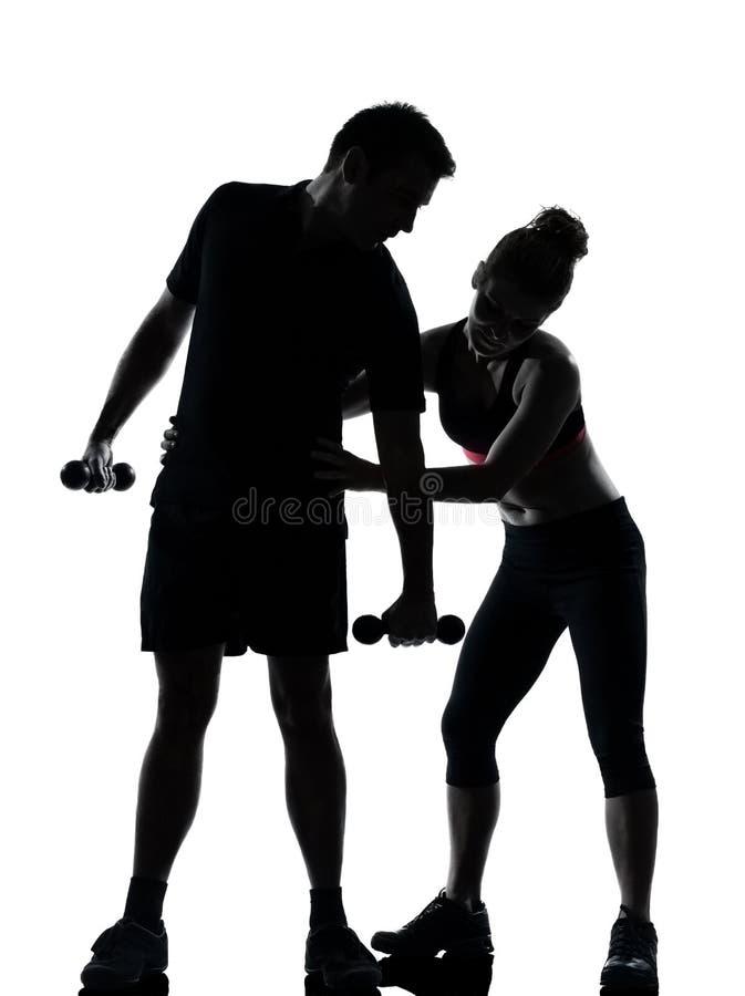 пары работая разминку женщины человека одного пригодности стоковое фото