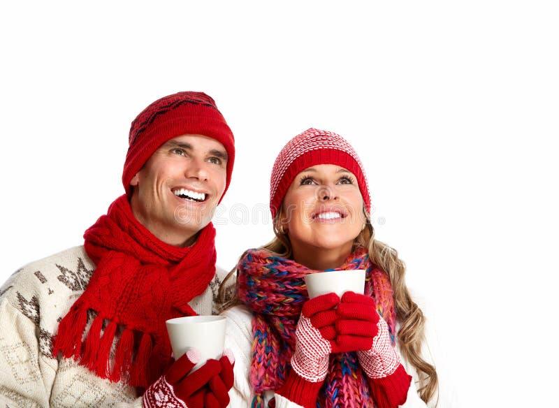 Пары рождества выпивая горячий чай. стоковое изображение