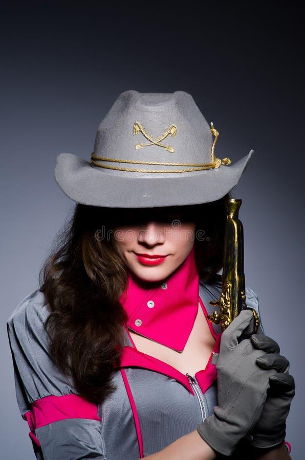 Пастушка женщины с оружием стоковое фото