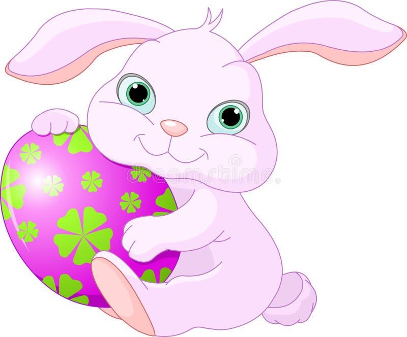 пасхальное яйцо держит кролика бесплатная иллюстрация