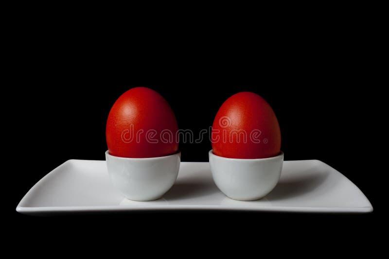 пасхальные яйца покрывают белизну красного цвета 2 стоковые фото