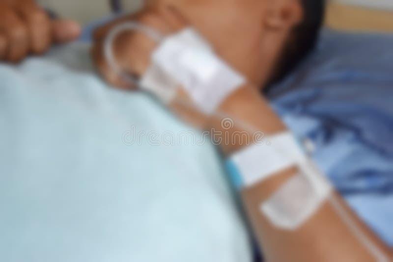 Пациенты спят на палате кровати и запачкают предпосылку стоковая фотография