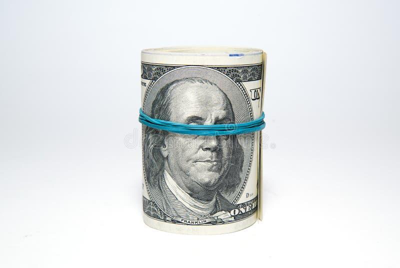Пачка банкнот долларов США дальше над белизной стоковые фото