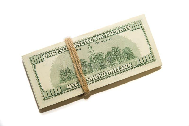 Пачка банкнот долларов США на белой предпосылке стоковая фотография rf