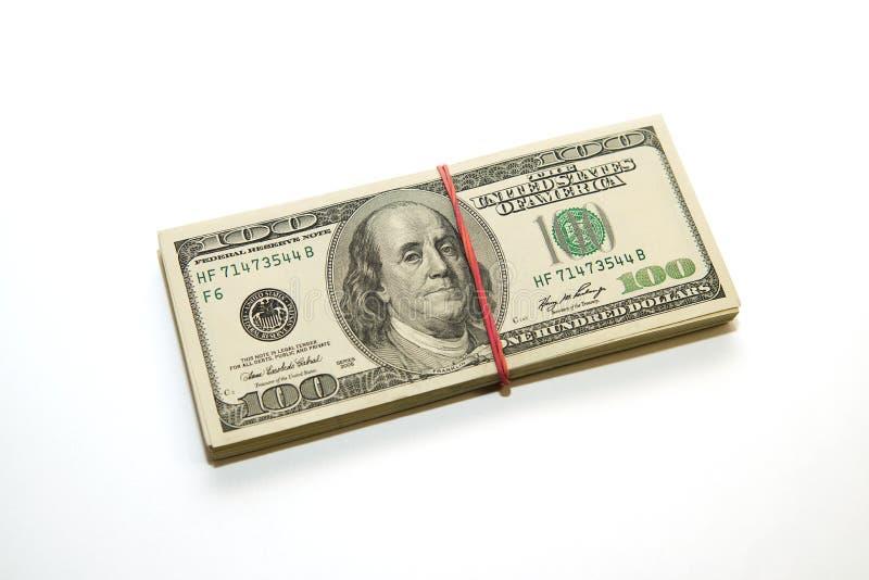 Пачка банкнот долларов США на белой предпосылке стоковое фото rf