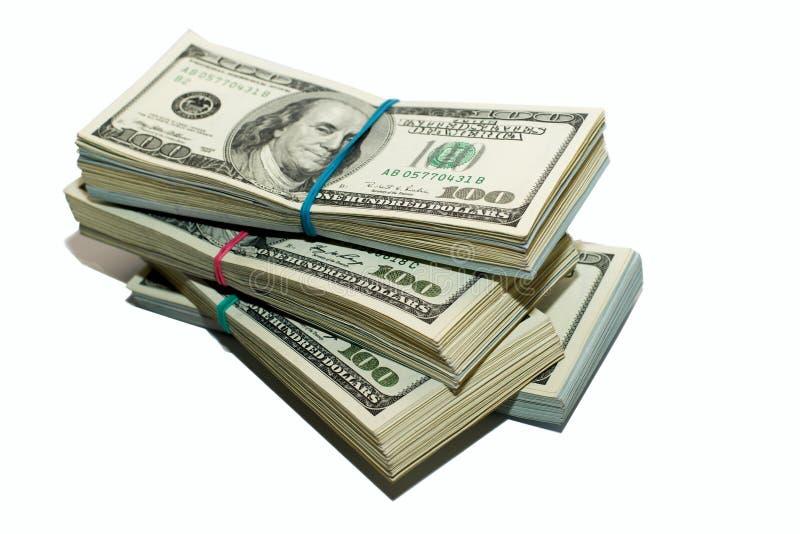 Пачки банкнот долларов США на белой предпосылке стоковые изображения rf
