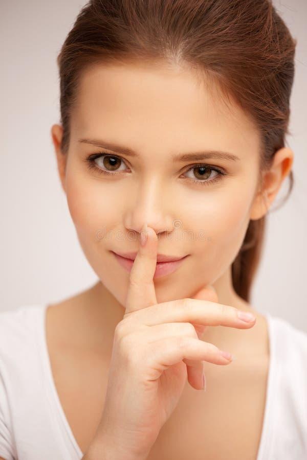 Палец на губах стоковое фото
