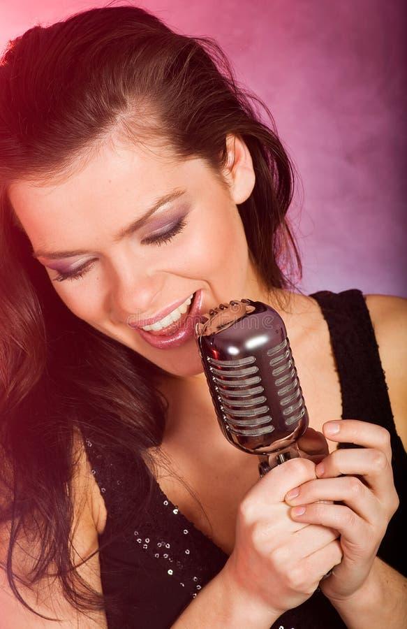 певица девушки стоковая фотография rf