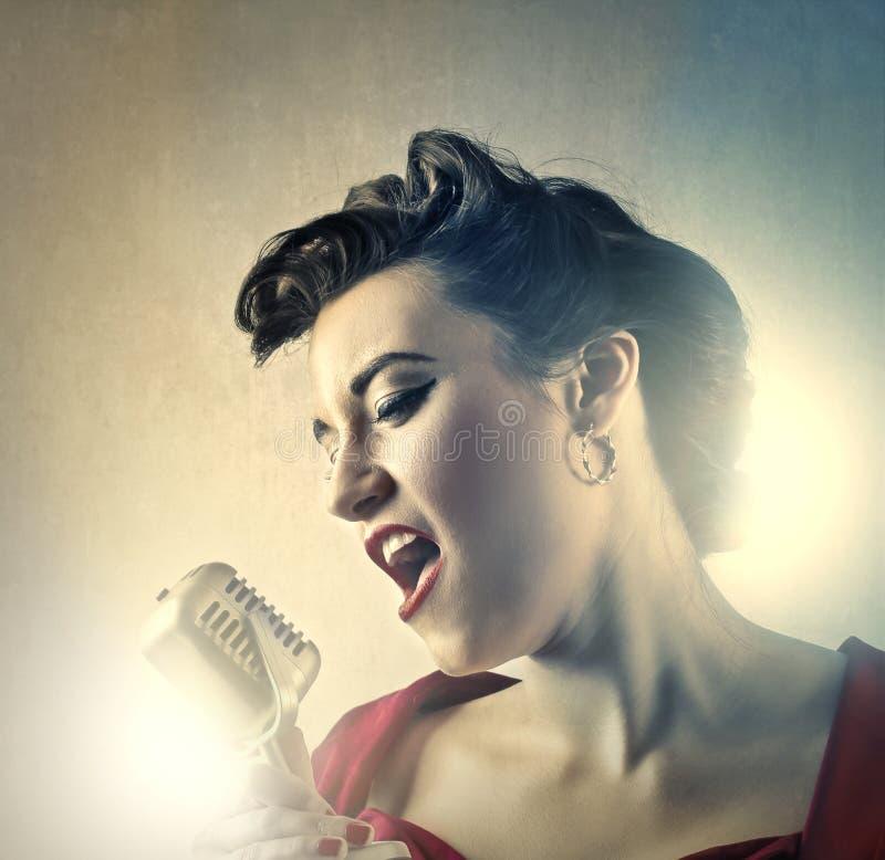 Певица женщины стоковое фото