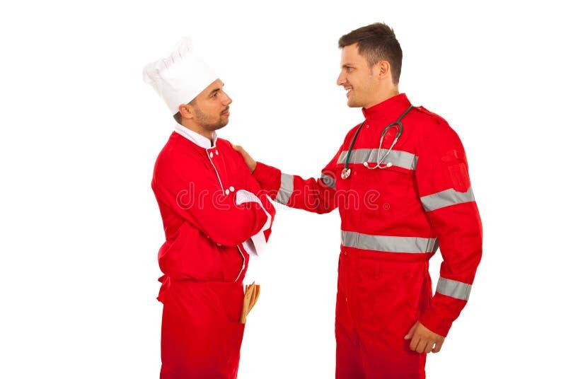 Первое собрание медсотрудника и шеф-повара стоковое фото