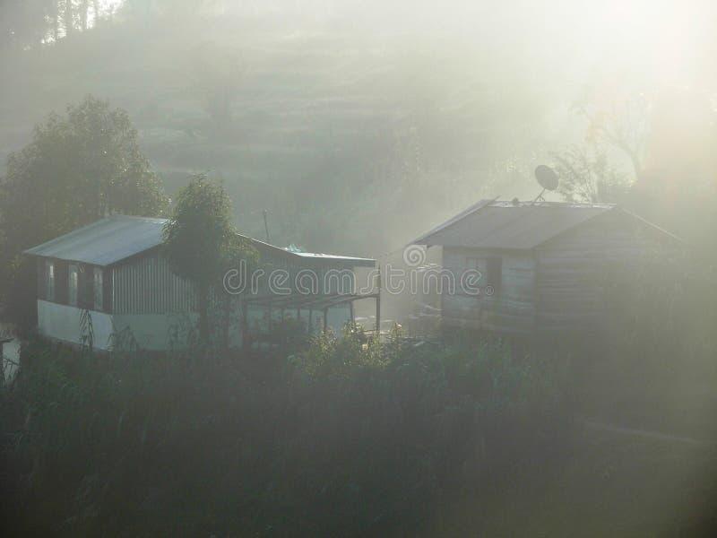 Первые лучи солнца утра на Chatakpur стоковая фотография