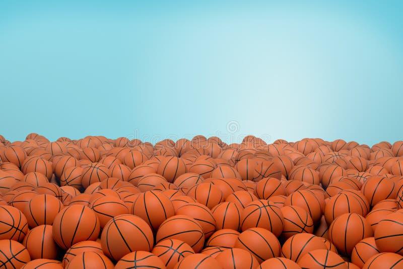 перевод 3d бесконечной кучи оранжевых шариков баскетбола с черными нашивками лежа в куче на голубой предпосылке стоковая фотография