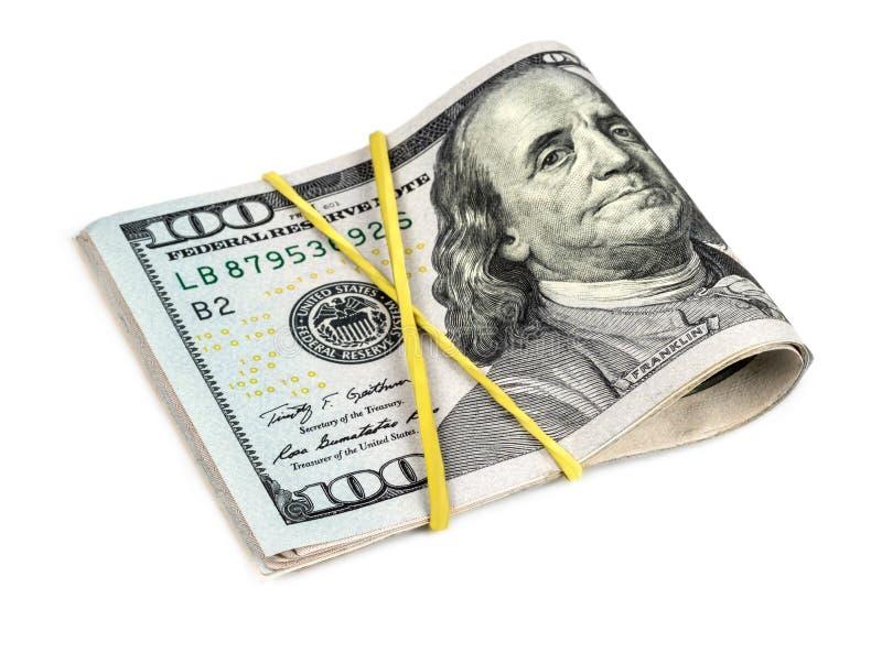 Перевязанные доллары на белой предпосылке стоковое изображение