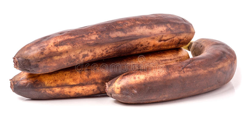 Перезрелые бананы перед белой предпосылкой стоковые изображения rf
