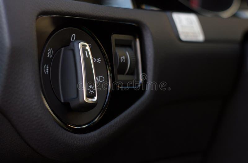 Переключатель управления светом автомобиля внутренний стоковые изображения