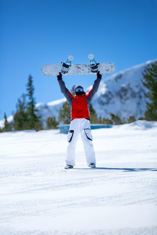 перекрестное влияние обрабатывая snowboarder snowboard стоковые фото