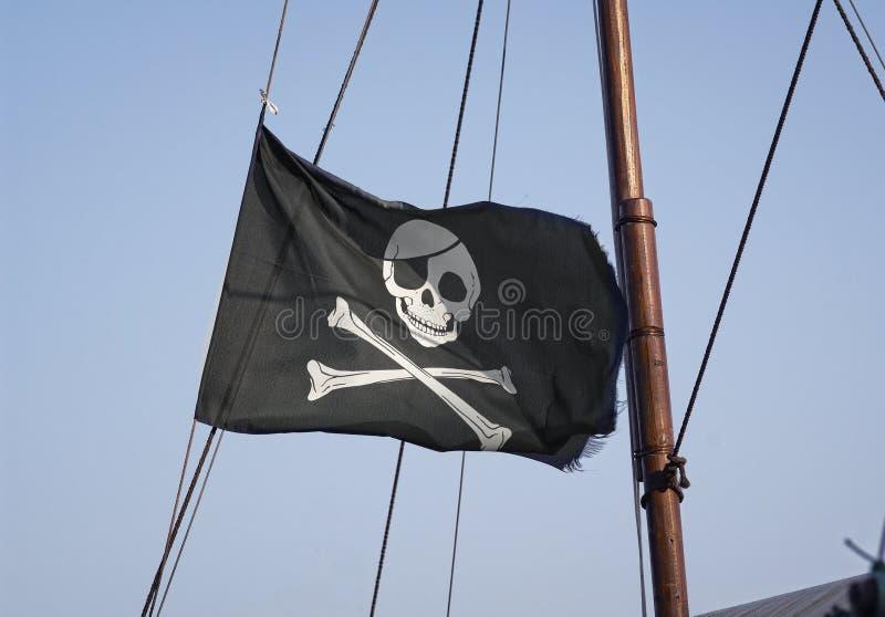 перекрещенные кости flag весёлый череп roger стоковое изображение rf