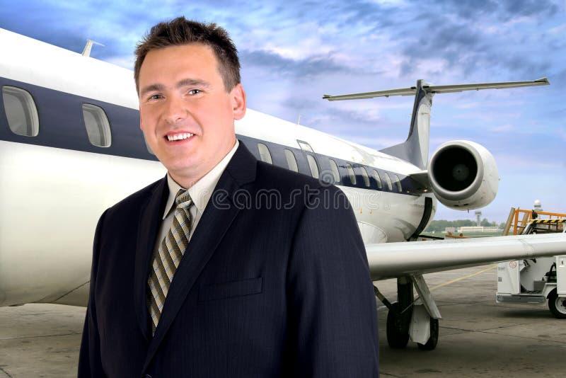 перемещение бизнесмена самолета стоковое изображение