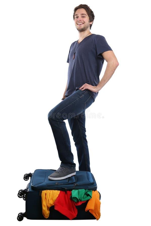 Перемещение молодого человека сумки багажа чемодана упаковки путешествуя каникулы стоковое фото