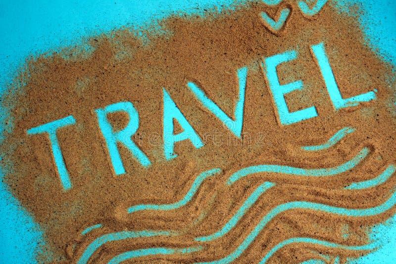 Перемещение слова написано на песке стоковое изображение rf