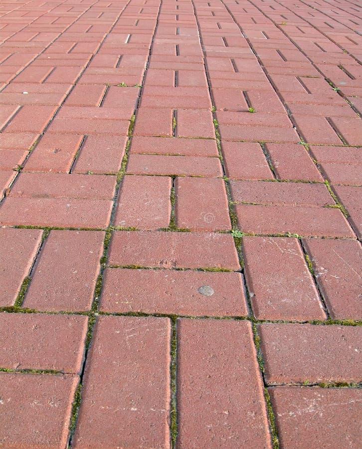 перемещение улицы принципиальной схемы кирпича красное стоковое фото rf