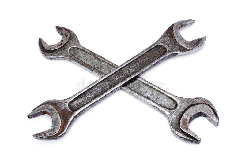 Пересеченные затрапезные ключи на белой предпосылке стоковое фото rf