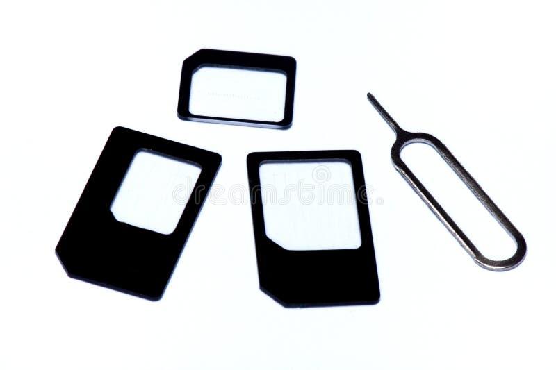 Переходники карточки SIM и инструмент извлечения стоковые изображения rf