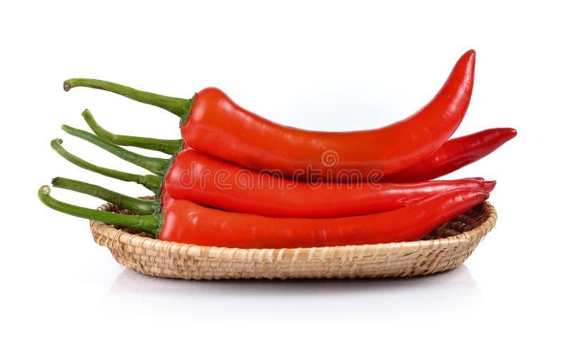 Перец красного chili в корзине изолированной на белой предпосылке стоковое фото rf