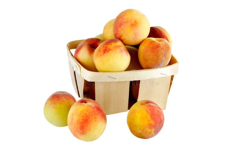 Персики в корзине стоковая фотография rf