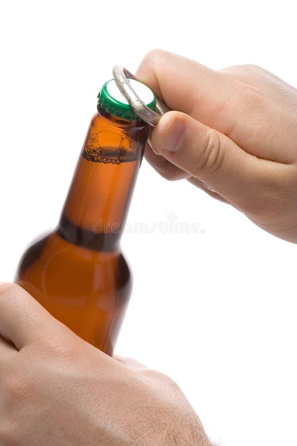 персона отверстия бутылки пива стоковое изображение