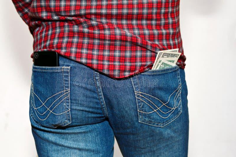 Персона с опасной вставляет вне от карманных денег стоковые фотографии rf